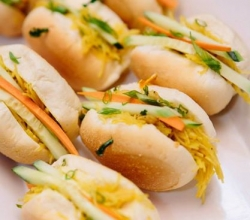 """Filipino Sliders"" Spring noodles with chicken, in a Traditional Filipino Sweet Roll garnished with fresh cucumber and carrots."